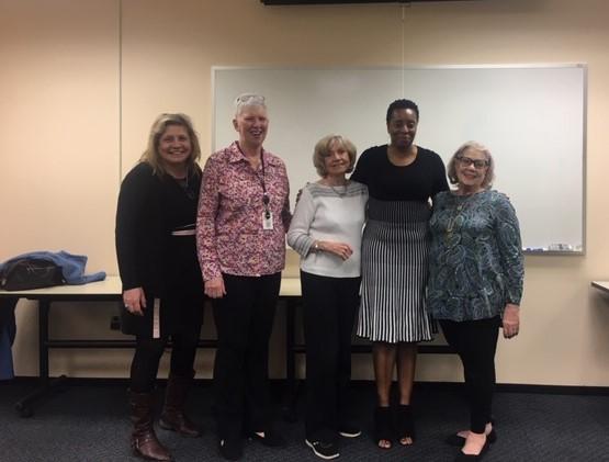 Ms. Carmen Hackett, shown with Patricia Sanguinetti from Arlington Community High School, Meg Tuccillo, Maryann Ullrich, and Susan Senn of AAUW.